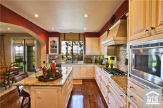 Nice kitchen with some red hues.