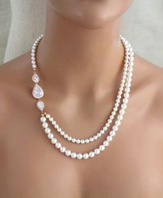This lovely necklace I created using rose gold plated cz teardrop components finished with 2 strands of Swarovski pearls. Necklace measures 18 inches on inside strands and extends to 20 inches. This is an original design by © Treasures by Agnes READY TO SHIP AS PICTURED WITH CREAM /