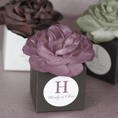 Sweet gift wrap ideas for small gifts--love the silk flower in place of tissue paper.