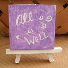 """Affirmation Art, Acrylic Painting on Mini Canvas, All Is Well, Small Reminder Artwork, 3"""" x 3"""" Canvas, White Painted Easel, Purple Lavender by SubtleHarmony on Etsy"""