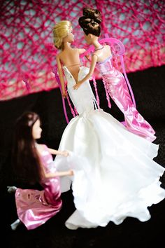 Zipping Barbie into her wedding dress!