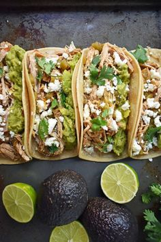 Slow cooker pork cooked in orange juice, lime juice, jalapenos, chilies and spices. Taco topped with guacamole and cilantro. Pork Recipes, Cooking Recipes, Crockpot Recipes, Pork Carnitas Tacos, Beef Barbacoa, Chicken Chilaquiles, Green Chili Pork, Pork Enchiladas, Cinco De Mayo