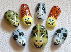 rock painting ..painting on rocks and stones | Found Art Hand Painted Stones""