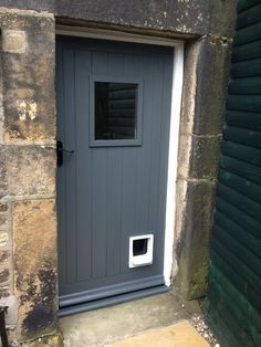 Front door in Farrow and Ball Down Pipe