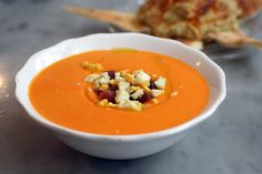 A quick and easy Spanish salmorejo recipe straight from my Spanish mother-in-law's kitchen. This creamy cold tomato soup is perfect in summer, try it today!