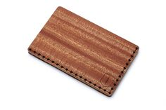 Red Note cardholder SS'2017. The Red Note wooden card holder combines craftsmanship, style and functionality. Made out of two natural types of wood – mahogany and beech, then paired with genuine leather, it is simple in design yet extremely expressive and ideal for your next business meeting. Get all your business cards in one place – there is enough space for up to 25 of them or choose to use it as your credit card holder with up to 7 of them. Express your masculine sense of style with the…