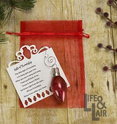 Let your friends know how much they mean to you this holiday season with this Light of Friendship Christmas ornament and poem. Available in red, blue, gold, green, pink or purple. Select your color choice from the drop-down box above. Each ornament is hand glittered on the inside (so there is no shedding). Each ornament comes complete with friendship poem on cardstock, silver swirly hook for hanging and red organza bag. Size: 2.375 glass bulb-shaped ornament (the size of a traditional…