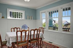Tall wainscoting with plate rail for the dining room