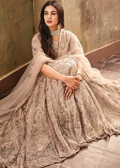 Sonal Chauhan Peach Color Net Designer Anarkali Suit Spread the aura of freshness with this peach color net designer Anarkali suit showing a touch of sensuality. The embroidered, lace and resham work on attire personifies the entire appearance Bridal Anarkali Suits, Bridal Lehenga, Salwar Suits, Wedding Lehnga, Desi Wedding, Wedding Ideas, Salwar Kameez, Indian Dresses, Indian Outfits