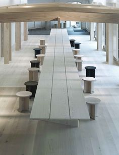 Custom stools can be pulled out to create a dining space. A wood pergola surrounds the table. Photo 2 of 6 in Generations-Old Danish Wood Firm Dinesen Unveils Spiffy Copenhagen Showroom. Browse inspirational photos of modern homes. Showroom Design, Cafe Design, House Design, Design Design, Cottage Interiors, Office Interiors, Cafe Interior, Interior And Exterior, Luxury Interior
