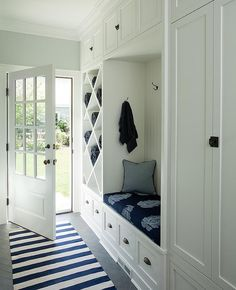 Gorgeous white and blue mudroom features light gray walls framing a glass panele. Gorgeous white and blue mudroom features light gray walls framing a glass paneled door opening to gray herringbone floor. Grey Striped Walls, Light Grey Walls, Gray Walls, Glass Panel Door, Panel Doors, Flur Design, Tile Covers, Suites, Frames On Wall