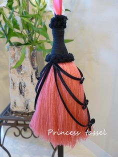 Pink and black tassel.