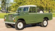 // 1966 Land Rover Series IIA 109 Pickup 2.25L, 4-Speed, Professional frame-up restoration - 800 miles on new engine - Detachable truck bed - Canvas supports included - Garaged entire time since restoration - Owner's, restoration and repair manuals included