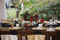 Gorgeous farm tables with black runners, gold chargers and pops, as well as fresh fruit! #cedarwoodweddings 10.21.17 :: Mallory + Steve | Cedarwood Weddings