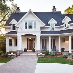 Love the front door and raised porch by door