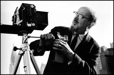Ansel Adams was a member of Group f/64, which promoted use of large-format view cameras, small lens apertures, and contact printing.   Ansel Adams by Cornell Capa, New York City, 1958