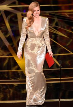 2017 Academy Awards: Amy Adams wears a shimmery plunging Tom Ford gown with Cindy Chao jewelry.
