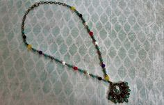 Check out this item in my Etsy shop https://www.etsy.com/listing/242720656/boho-beaded-pendant-necklace-of-brass