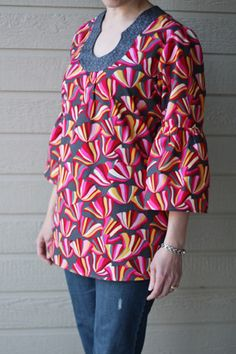 Shorten the ruffles (or omit them), this tunic would look cute!  Imagine this tunic in two contrasting solid colors--very classic!
