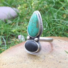 Turquoise & Beach Stone Ring , Sterling Silver, Size 8  This teal turquoise stone, accentuated with orange & brown matrix, sits aside a black