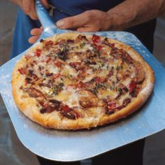 Mushroom and Fontina Pizza Recipe - courtesy of Saveur. Total flavor explosion.