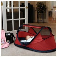 travelling co-sleeper pea-pod. Gives shade, and can even protect dweller from mosquitoes , when you do not nurse obviously