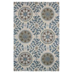 An artful anchor for your master suite or dining room, this hand-tufted wool rug showcases a suzani-inspired medallion motif in ivory.   ...