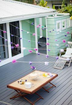 Pretty Tissue Paper Garland strung over a deck