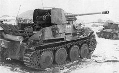 German Marder III, in the background is an abandoned Russian T-34 tank, 1943.