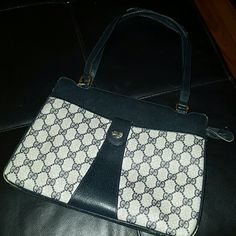 Vintage Gucci Handbag**PRICE DROP** 80's Navy Shoulder Bag-- just needs a little love! No marks or stains on the outside of the bag;  the inside shows it's age, but the wear and tear of handles (shown in pics) can be repaired. Gucci Bags