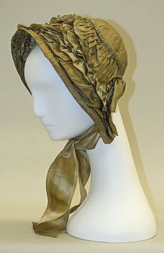 Historical. Muslin day caps were worn with ribbon or long lappets, like shown in the image. Bonnet Date: ca. 1850 Culture: American or European Medium: silk