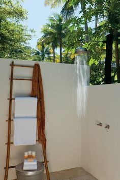 Take a shower under blue skies in Fiji paradise. Follow my board for more Fiji wedding inspiration.
