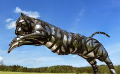 Jumping Tiger, used Tires, scrap stainless steel, recycling artist Mirko Siakkou-Flodin takes a leap in to the sustanability world, save the tiger Outdoor Sculpture, Sculpture Art, Sculptures, Save The Tiger, Tire Art, Trash Art, Tyres Recycle, Used Tires, Scrap Metal Art