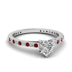 Shop heart shaped diamond engagement ring with red ruby in 14K white gold at Fascinating Diamonds. This diamond ring is designed in Pave setting