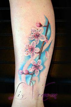 A beautiful cherry blossom tattoo by @Liz Mester Venom done at @Cristina Perim Ink Follow us on instagram!