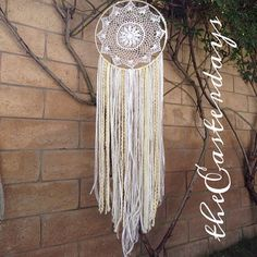 bohemian wedding dreamcatcher whites ivories by theeasterdays, $25.00. Don't know what I think about this one but it's a cute idea.