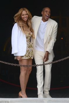 Having a blast: Beyonce and Jay Z were able to laugh about the fact tourists were more interested in snapping them than the historical landmark