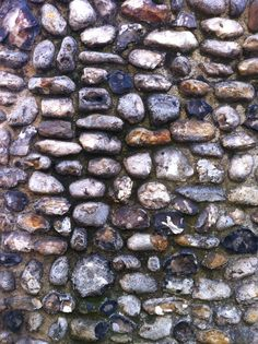 City wall made of flint and strengthened with brick and stone