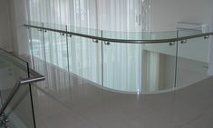 Curved Glass Balustrade with stainless steel handrail! by Elite Balustrades Frameless Glass Balustrade, Stainless Steel Handrail, Curved Glass, Safety Glass, Glass Panels, Custom Design, Interior, The Originals, Space