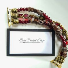 Rustic Table Cut Glass, Red Glass Beads with square Wood Chip Brown Apple iWatch Band. Features Gold Adaptors. Our collection is growing weekly with new materials along with creative designs.