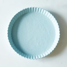Blue Tart Plate - from Food52. Unglazed, non-stick surface, dishwasher safe.  $68.