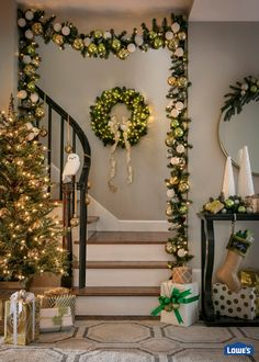 Frame your staircase arch with dramatic pre-lit garland filled with metallic ornaments. Carry your chosen color scheme through with coordinating wreath, tree, stockings, and accessories.