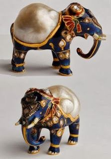 Gold and enamel figurine of an elephant with large natural baroque pearl forming its back and diamonds on its head.