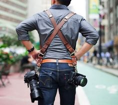 Leather Multi Camera Strap / The regular chestnut MoneyMaker Multi-Camera Harness from HoldFast is a high-grade leather harness designed to hold two cameras near your hips. http://thegadgetflow.com/portfolio/leather-multi-camera-strap/