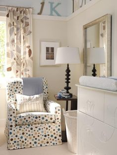 Unexpected Palette  When designing kids' rooms, Sarah always tries to stay away from the conventional. Rather than juvenile prints and pastel colors, Sarah opted for a sophisticated, leaf-print linen for the drapes and a coordinating color palette of muted grays, pale blues and soft browns. A piece of flat trim installed all the way around the room plays up the two-color paint scheme.