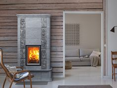 Find out all of the information about the TULIKIVI product: wood heating stove / soapstone / traditional / 20 kW AKKO. Wood, House, Fireplace Heater, Home, Fireplace Design, Soapstone, House Inside, Stove, Fireplace
