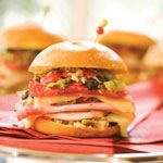 Easy Mini Muffulettas Recipe | MyRecipes.com--Easy Mini Muffulettas A New Orleans specialty, muffuletta sandwiches originated in 1906 at the Central Grocery. This easy version from Southern Living calls for traditional Genoa salami, provolone cheese, and an olive salad topping.