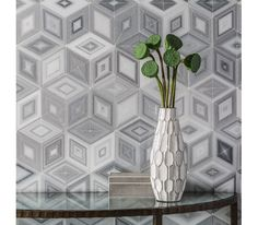 #‎DailyProductPick‬ AKDO Tile's Origami Collection combines geometry and nature to create striking patterns in marble. #design #interiordesign #interiordesignmagazine #products #marble @akdousa