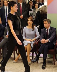 Special guests: The royal couple sat front row at Danish haute couture designer Jesper Hov...