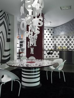 Black and white Missoni dining area. Abstract dining room. Stripes. Dots. Letter light fixture.